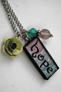 One of the pendant necklaces created by American friend Penny Taylor with Wanja's artwork