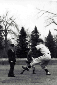 Rick Ferguson pitching for St. Mary's High School, 1965. Photographer unknown.