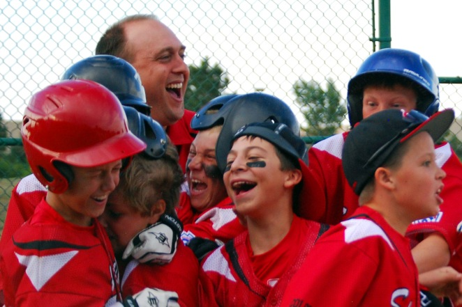 Baseball victory, my husband coaching one of our son's teams, 2012. (c) Colleen Briggs.