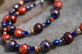 Necklace made with fair-trade ceramic Kazuri beads from Kenya.