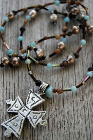 "Necklace made with ""fair-trade standard"" metal beads and Coptic cross from Ethiopia."