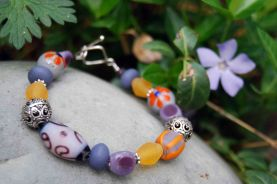 """Bracelet made from glass beads made by a """"fair-trade standard"""" cottage industry in Indonesia."""