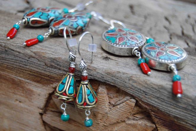 Earrings made with fair trade silver in-laid with turquoise and coral, made by Tibetan refugees in Nepal.