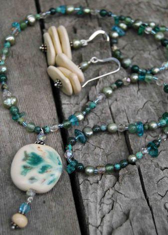 "Fair trade Kazuri (Swahili for ""small and beautiful"") ceramic pendant and earrings, made by single mothers from Kibera slum, Kenya."