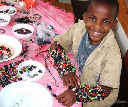 Sammy creating jewelry for Pamba Toto