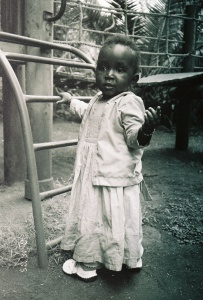My daughter, Lily, at Amani ya Juu playground, 2005.