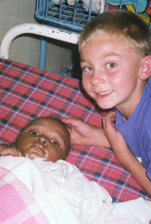 My son with Lily when we met her at the orphanage, 2004