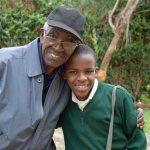 Sammy with Pastor Karau