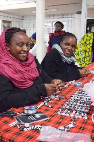 Kenyan artisans, fashioning Kazuri beads