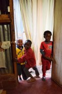 Children crowding the door into Tuungane Pamoja's workshop, 2016. (c) Colleen Briggs