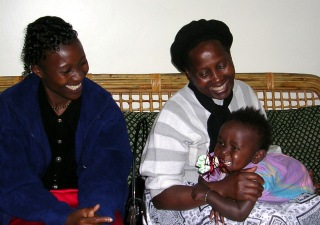 Our dear friends Purity and Mama Karau with Lily