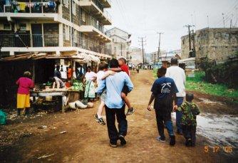 Muchira, carrying my boys through Kasarani to visit his house