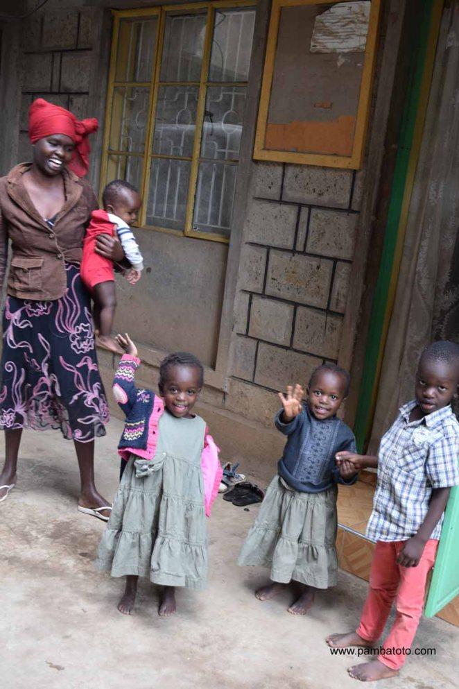 5 Korogocho artisan with children