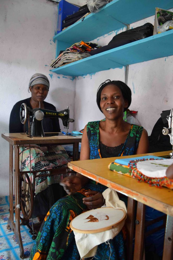 Maria (Rwanda) and Grace (Uganda), members of new Kibera artisan group